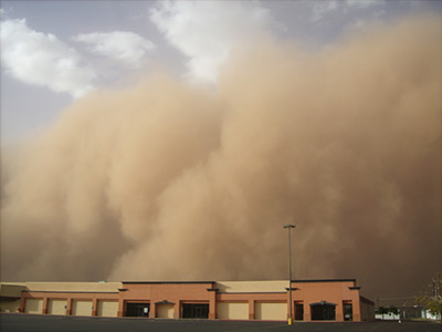 sandstorm looms over building